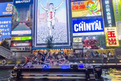 Osaka Wonder Cruise in front of the Glico Sign at Dotonbori.
